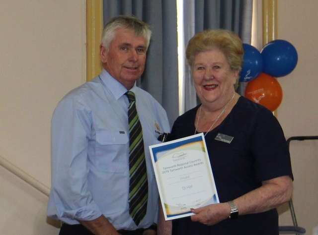 Photo of Counsellor Betts presenting 2019 Access Award Individual Winner to Di Hall